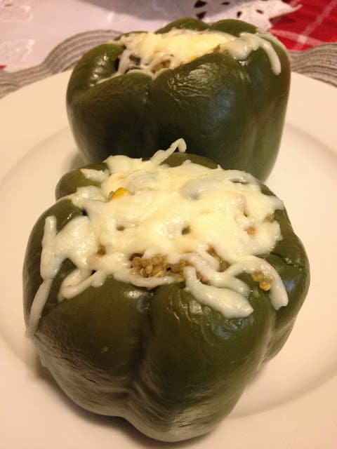 Green stuffed peppers covered in melted cheese