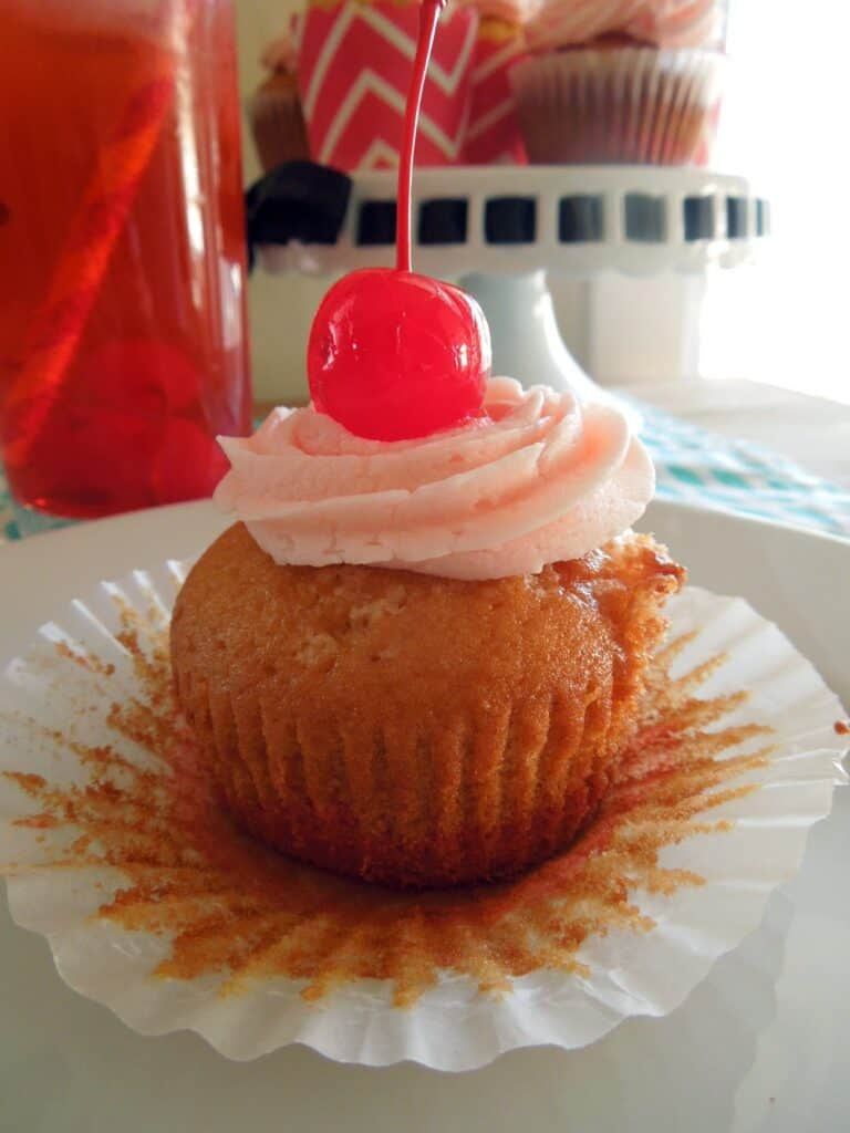 Shirley Temple cupcakes topped with a cherry