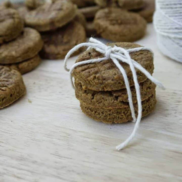Round dog treats tied with a small white rope