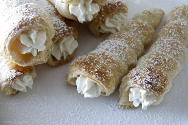 Cream Horns: Delicate, flaky puff pastry cones filled with sweet whipped cream. | stressbaking.com