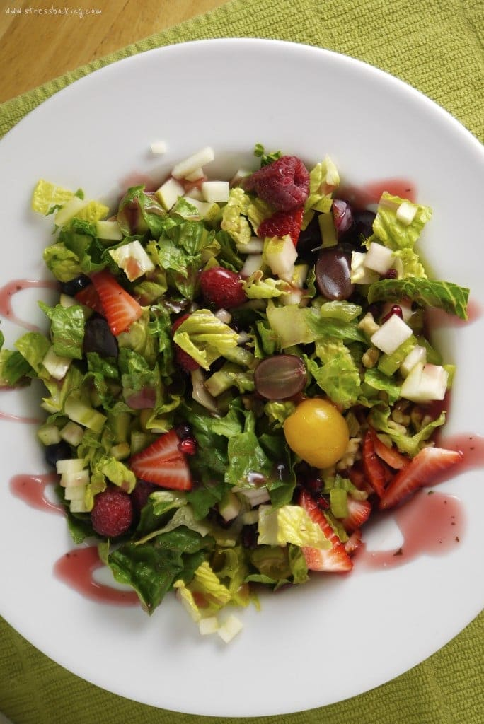 Overhead shot of colorful salad in a big white bowl