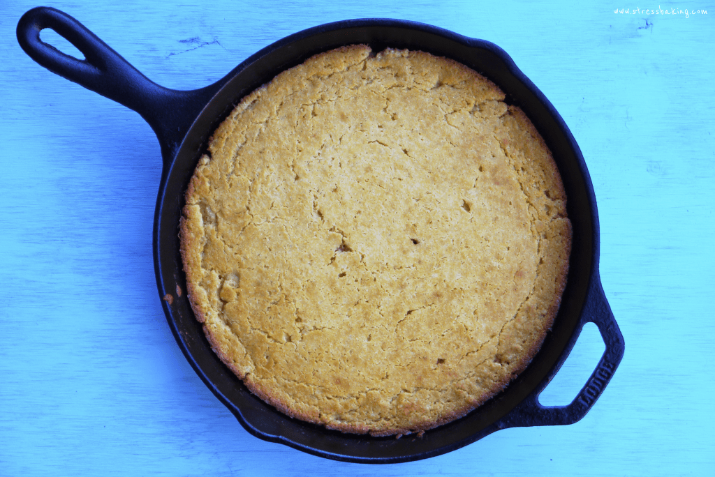 Overhead shot of freshly baked cornbread in a skillet