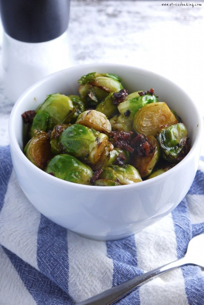 Pan Fried Brussels Sprouts with Bacon: These brussels sprouts are pan-fried with crumbled bacon and butter for a light and flavorful side dish! | stressbaking.com