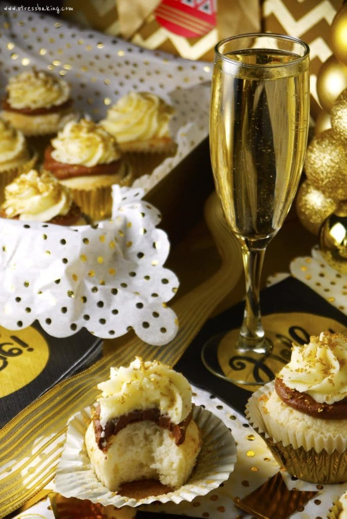 Champagne Cupcakes: Fluffy white cupcakes topped with a chocolate ganache and mascarpone buttercream, and all of them are infused with a zing of champagne. The perfect New Year's Eve treat! | stressbaking.com