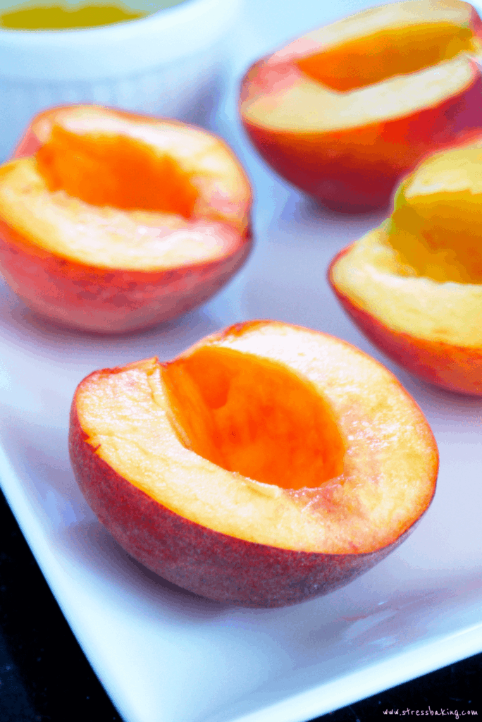 Sliced peaches on a white platter
