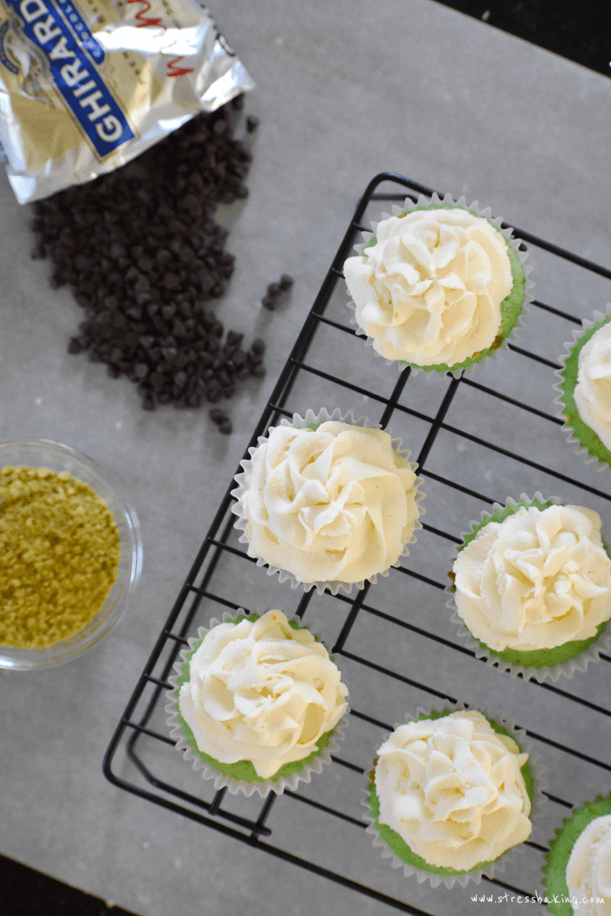 Pistachio cupcakes with cannoli frosting: Gorgeously green, light, fluffy pistachio cupcakes topped with a creamy cannoli frosting with hints of orange and lemon zest! | stressbaking.com
