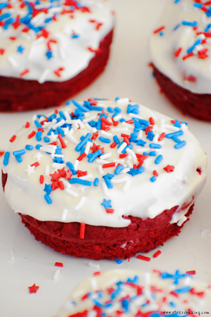 Easy Red Velvet Donuts with Cream Cheese Frosting: Fluffy red velvet donuts are made easy with boxed cake mix and topped with tangy cream cheese frosting! | stressbaking.com