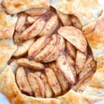 Paleo Apple Galette: Tart apples combine with the sweet flavors of cinnamon, honey and coconut sugar, a crispy gluten free crust and a slightly nutty maple drizzle for the perfect fall dessert!   stressbaking.com