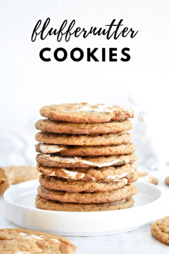 Stack of peanut butter cookies swirled with marshmallow fluff on a white plate