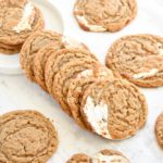 Fluffernutter Cookies: The classic New England fluffernutter sandwich is turned into a cookie! Thin, chewy peanut butter cookies are filled with swirls of marshmallow fluff.   stressbaking.com
