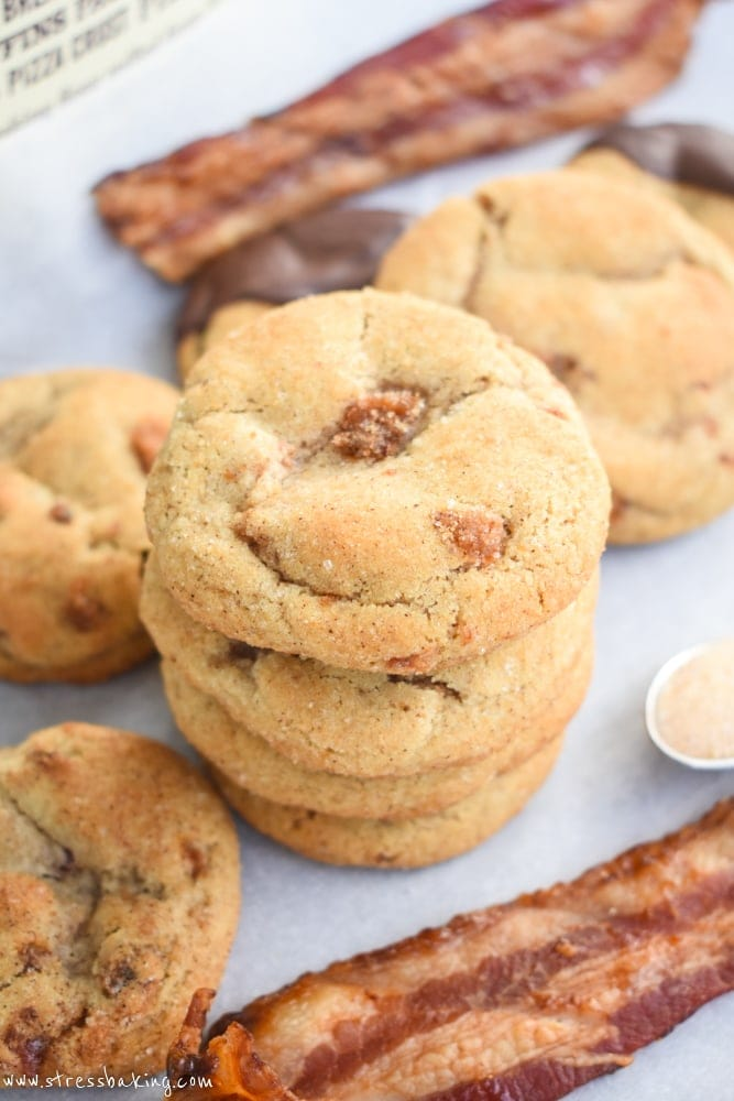 Maple Bacon Snickerdoodles: Chewy, soft snickerdoodles are kicked up a notch with maple flavor, candied bacon, and a drizzle of dark chocolate! | stressbaking.com