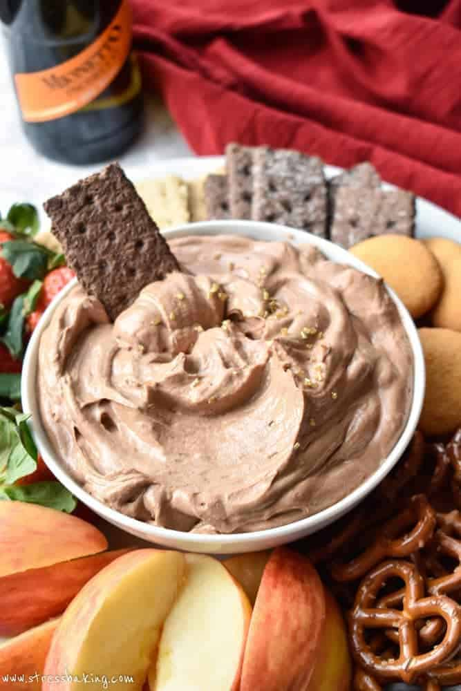 Nutella Champagne Dip: A super creamy, fluffy, whipped Nutella dip that gets a tangy upgrade from the addition of champagne. Pairs perfectly with fruit, graham crackers, pretzels and more!   stressbaking.com #holidays #boozy #dessert #champagne #nutella #newyearseve #partydip