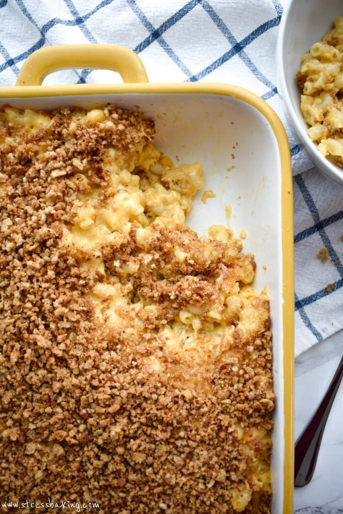 An overhead shot of baked mac and cheese topped with breadcrumbs in a casserole dish