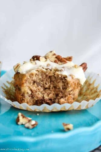 Hummingbird Cupcakes: Hummingbird cake is a classic southern favorite! I've made them into perfectly moist cupcakes filled with bananas, pineapple, and toasted pecans and topped with a tangy cream cheese frosting. | stressbaking.com #hummingbirdcake #banana #pineapple #cupcakes #creamcheese #frosting