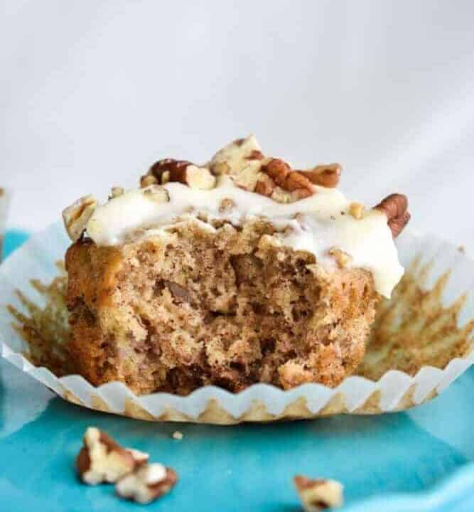 Hummingbird Cupcakes: Hummingbird cake is a classic southern favorite! I've made them into perfectly moist cupcakes filled with bananas, pineapple, and toasted pecans and topped with a tangy cream cheese frosting.   stressbaking.com #hummingbirdcake #banana #pineapple #cupcakes #creamcheese #frosting