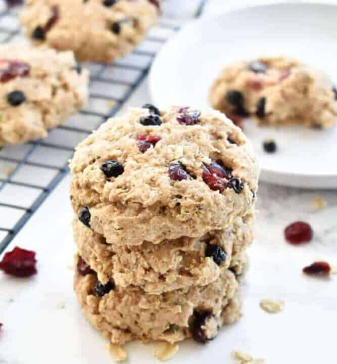 A stack of Paleo Banana Berry Breakfast Cookies on a white counter