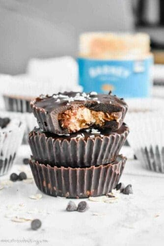 Paleo No-Bake Cowboy Cookie Cups: These cookie cups are like an almond butter cup and a cowboy cookie had a baby. Chewy oats, coconut and crunchy pecans are coated in smooth chocolate for a no-bake, no refined sugar, no gluten, no dairy, all paleo dessert!   stressbaking.com #stressbaking #cowboycookies #cookiecups #nobake #nobakedessert #dessert #almondbutter #paleo #glutenfree #refinedsugarfree #dairyfree #vegan