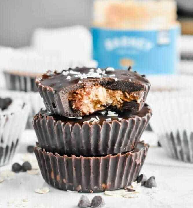 Paleo No-Bake Cowboy Cookie Cups: These cookie cups are like an almond butter cup and a cowboy cookie had a baby. Chewy oats, coconut and crunchy pecans are coated in smooth chocolate for a no-bake, no refined sugar, no gluten, no dairy, all paleo dessert! | stressbaking.com #stressbaking #cowboycookies #cookiecups #nobake #nobakedessert #dessert #almondbutter #paleo #glutenfree #refinedsugarfree #dairyfree #vegan