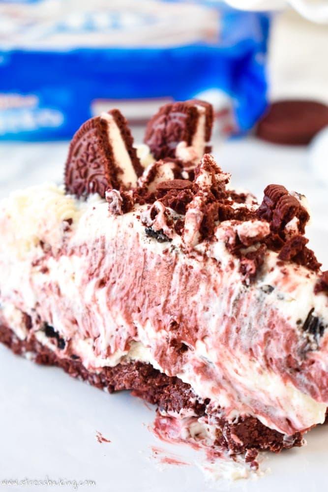 Red Velvet Oreo No-Bake Cheesecake: Supremely rich and creamy cheesecake filled with red velvet and Oreo flavors atop a Red Velvet Oreo crust. No baking required!| stressbaking.com #redvelvet #cheesecake #oreo #nobake #dessert