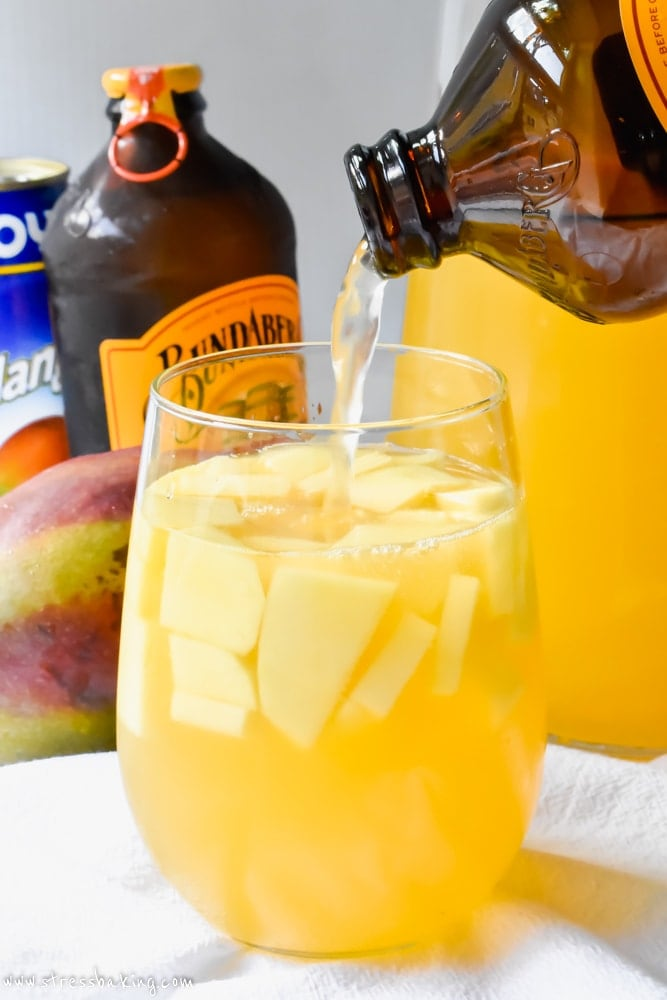 Ginger beer being poured into mango ginger sangria