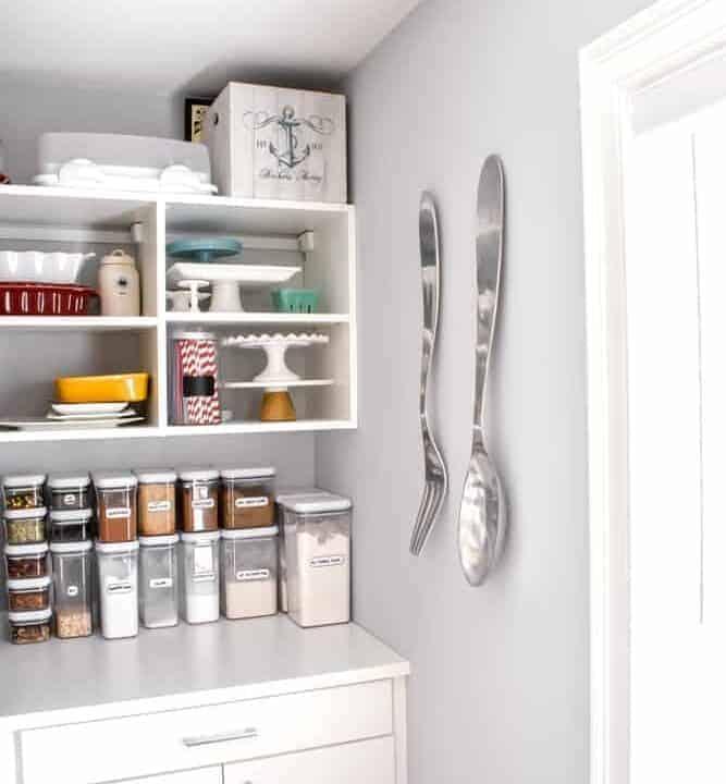 California Closets White pantry corner with white stool