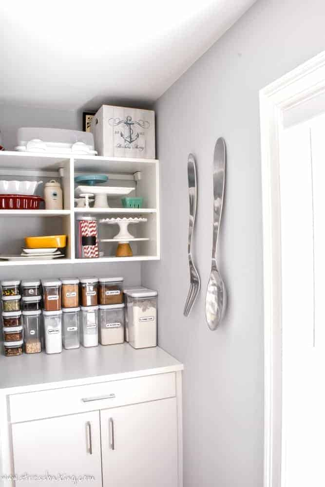 California Closets White pantry corner with white stool