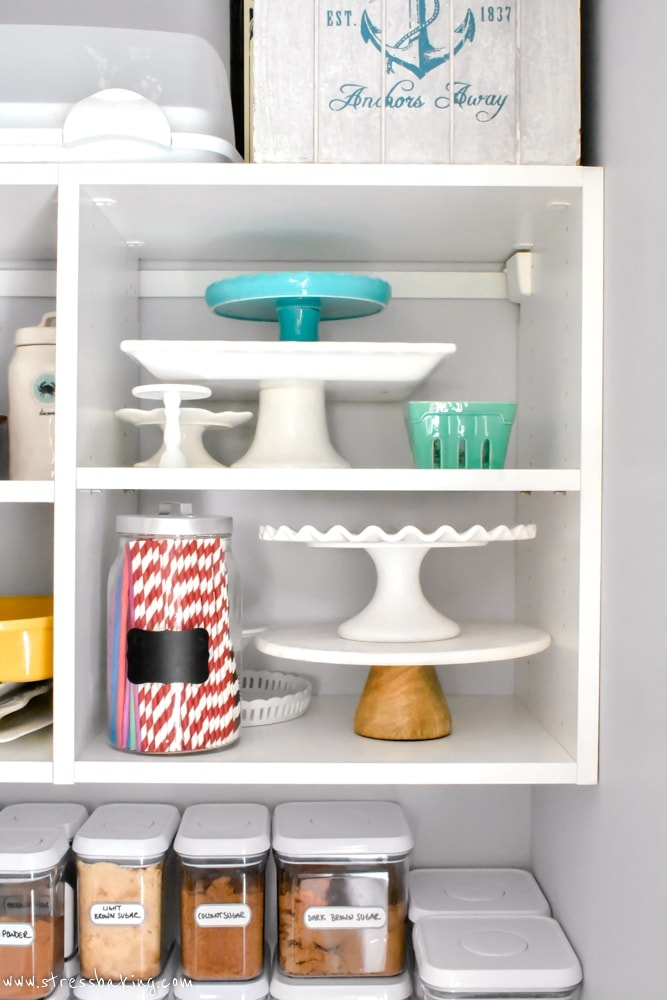 California Closets White pantry shelving holding cake stands