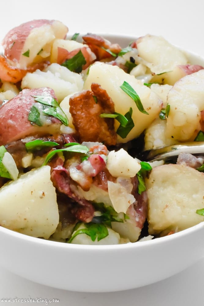 My favorite traditional German potato salad dressed with a dijon vinegar dressing and served warm. The perfect cold weather side dish!