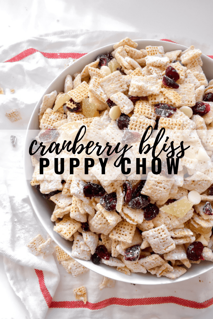 Cranberry Bliss Puppy Chow: Dried cranberries, white chocolate, crystallized ginger and orange flavors give this a winter holiday flavor blast! Addictive and easy to eat by the handful, you can call it puppy chow, muddy buddies, whatever you want - because no matter what, it's delicious! | stressbaking.com @stressbaking #stressbaking #puppychow #muddybuddies #chexmix #snack #cranberry #winter #holiday #holidays #christmas #dessert