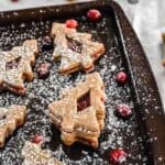 Gingerbread Linzer Cookies with Cranberry Cream Filling