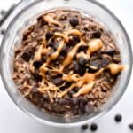 Overheat shot of chocolate and peanut butter overnight oats in a glass jar