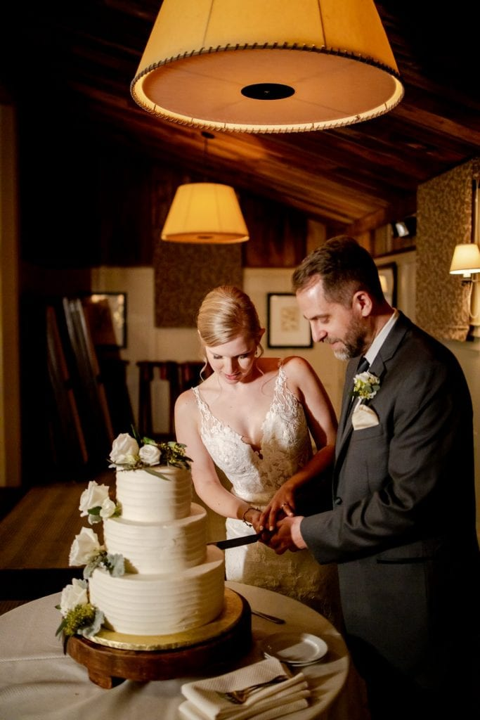 Leslie and Bill cutting their wedding cake