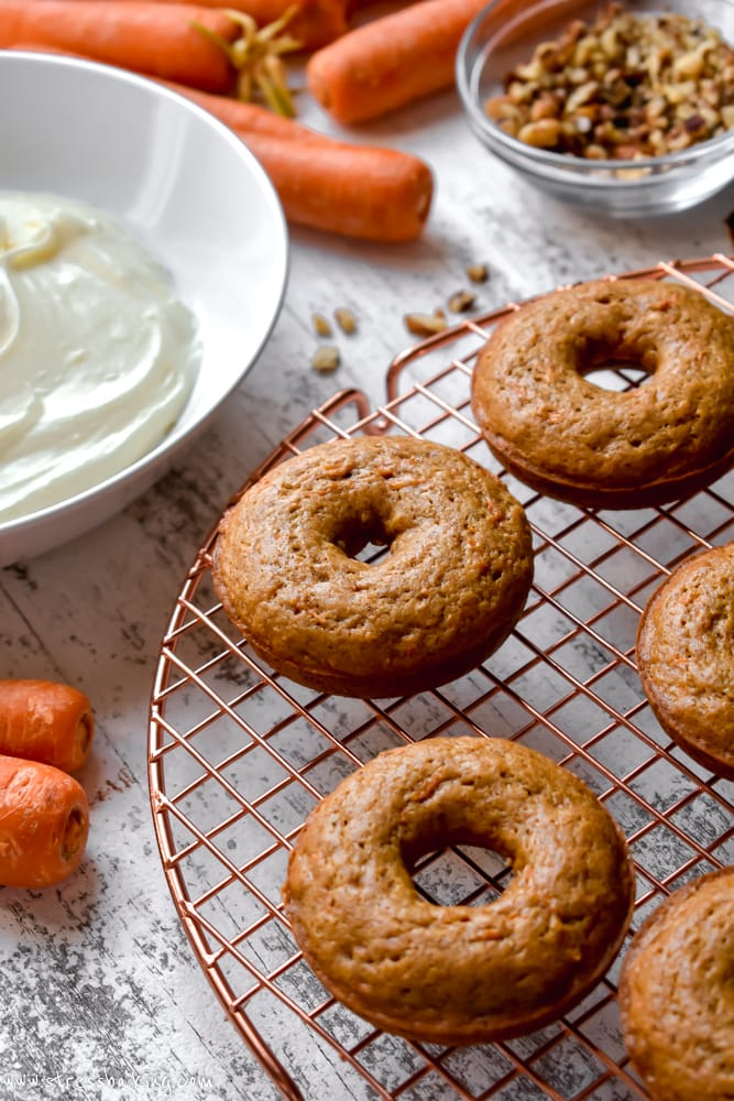 Carrot cake donuts on a gold wire rack