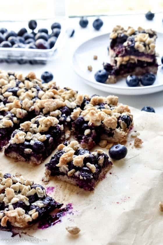 Sliced blueberry oatmeal bars on parchment paper