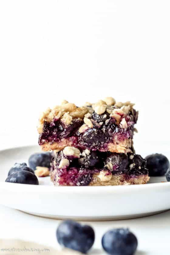 Blueberry Oatmeal Bars stacked on a plate