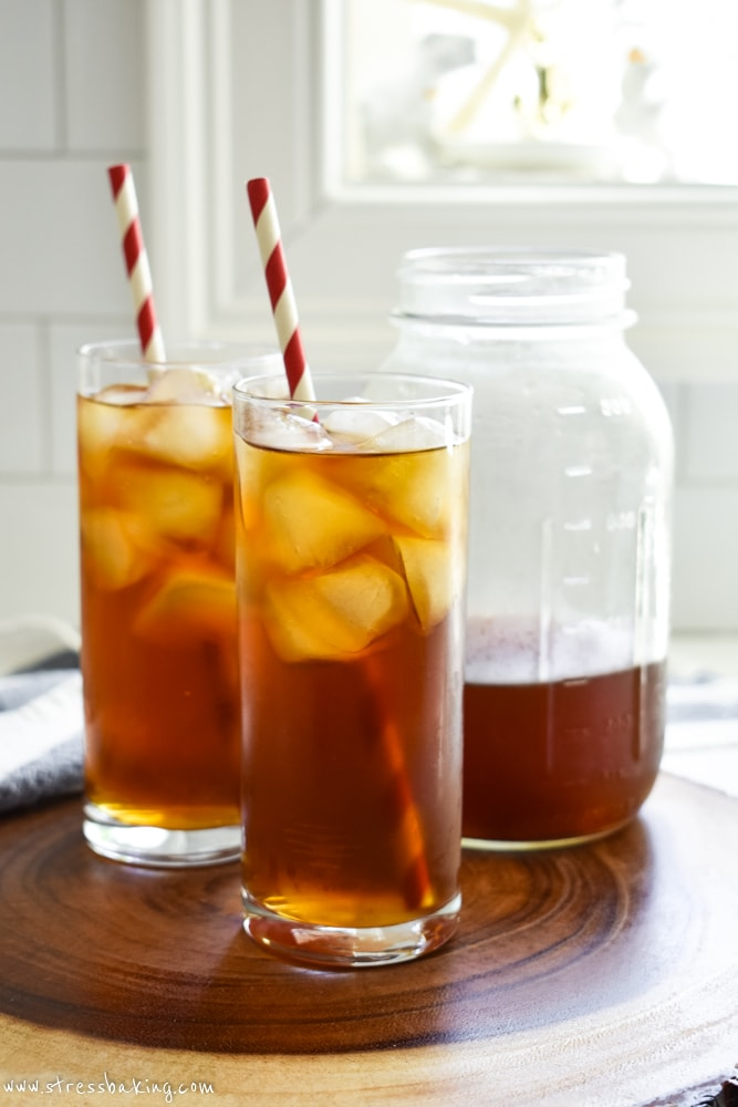 Cold brew coffee in tall glasses of ice with red and white straws