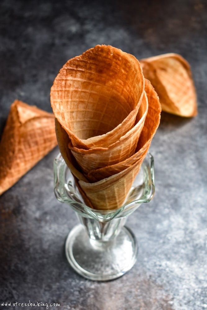 Waffle cones stacked in vintage glass ice cream dishes