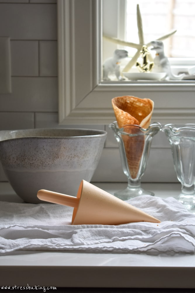 Waffle cone form on a white towel with a waffle cone and mixing bowl