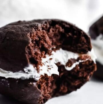 Chocolate whoopie pies with a bite taken out