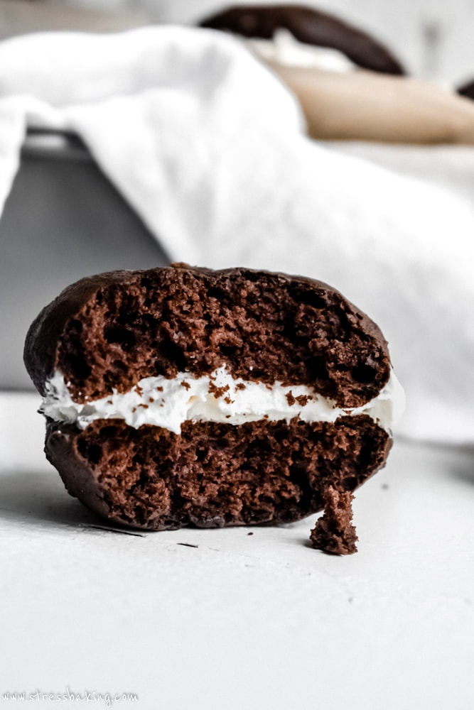 Chocolate whoopie pie with a bite taken out