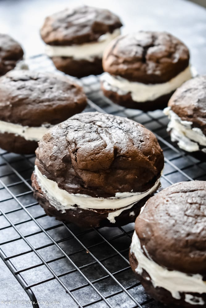 Many chocolate whoopie pies on a wire rack