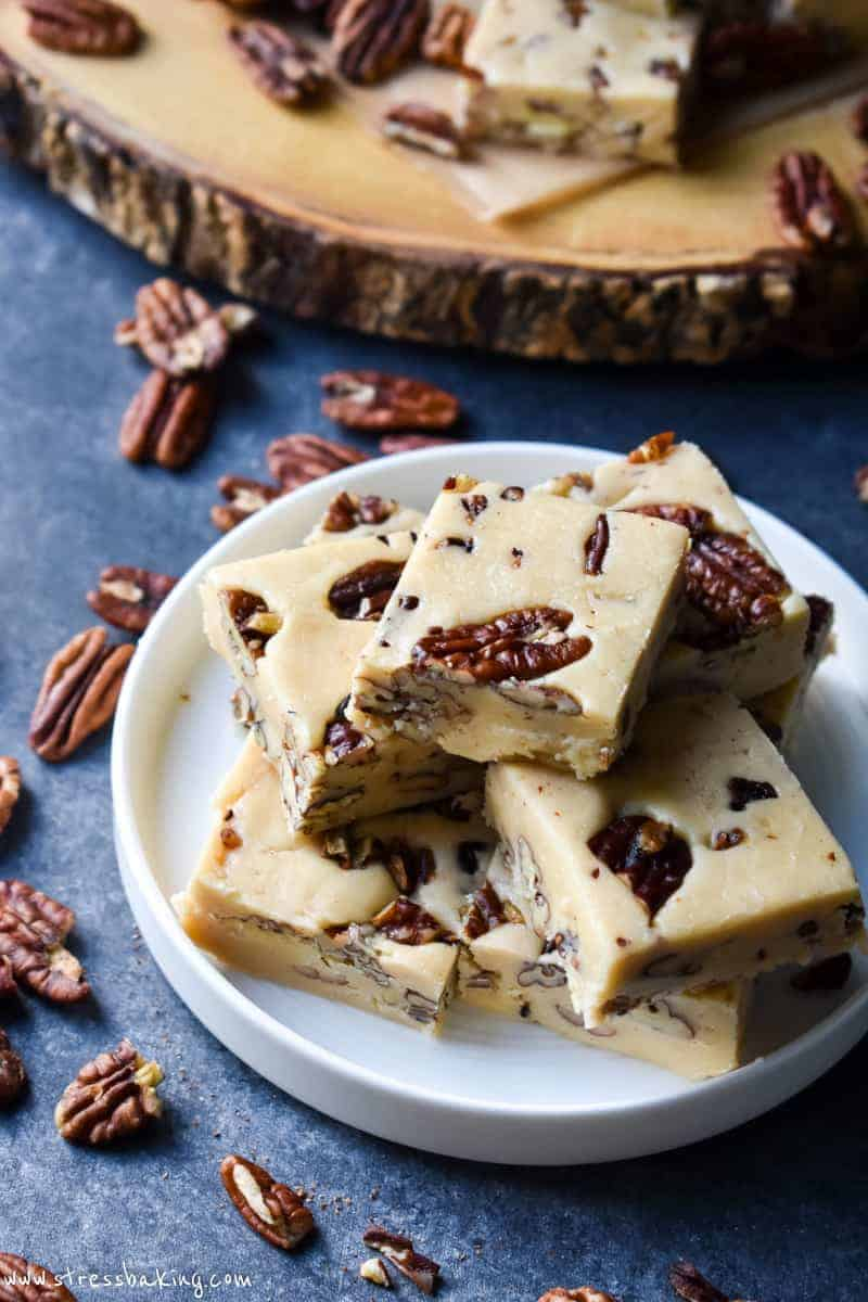 Overhead shot of butter pecan fudge stacked on a white plate