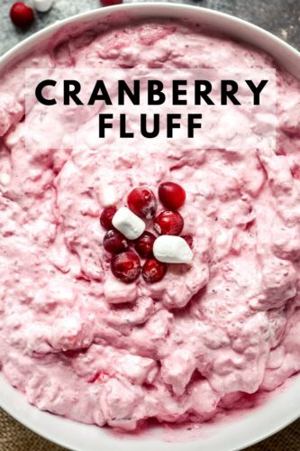 Overhead shot of vibrant pink cranberry fluff topped with marshmallows and cranberries