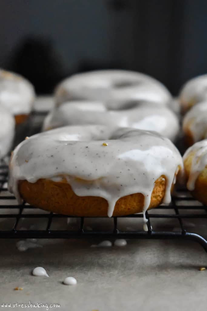 Side shot of eggnog donuts with glaze dripping down the sides