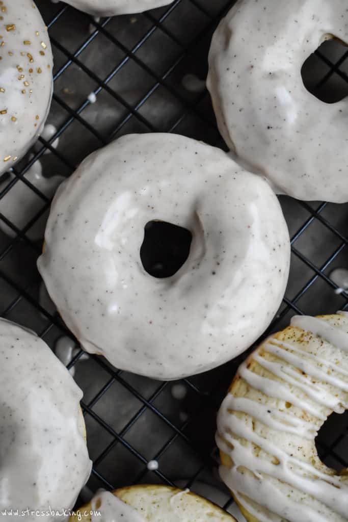 Eggnog donuts topped with a shiny eggnog glaze