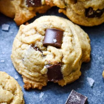 Close up of a peanut butter cookie with large chocolate chunks