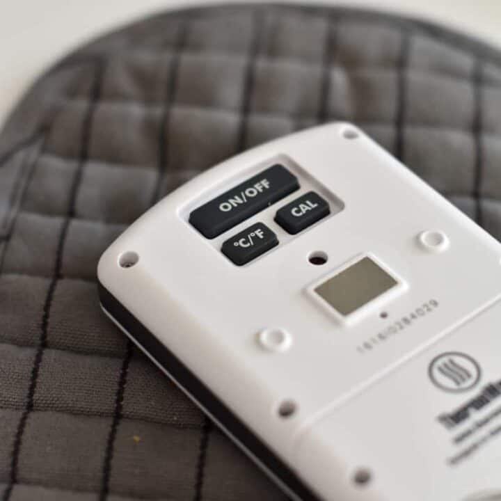 The back of a white ThemoWorks ChefAlarm showing the Celsius and Fahrenheit conversion button