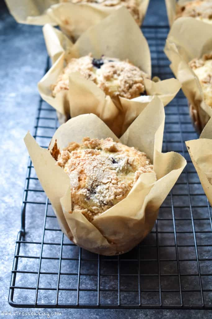 Blueberry muffin in a homemade parchment paper muffin liner