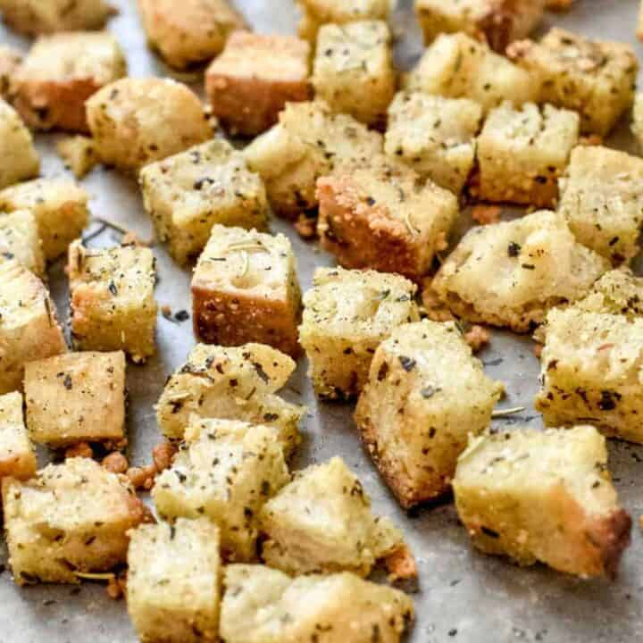 Freshly baked golden brown croutons on a baking sheet