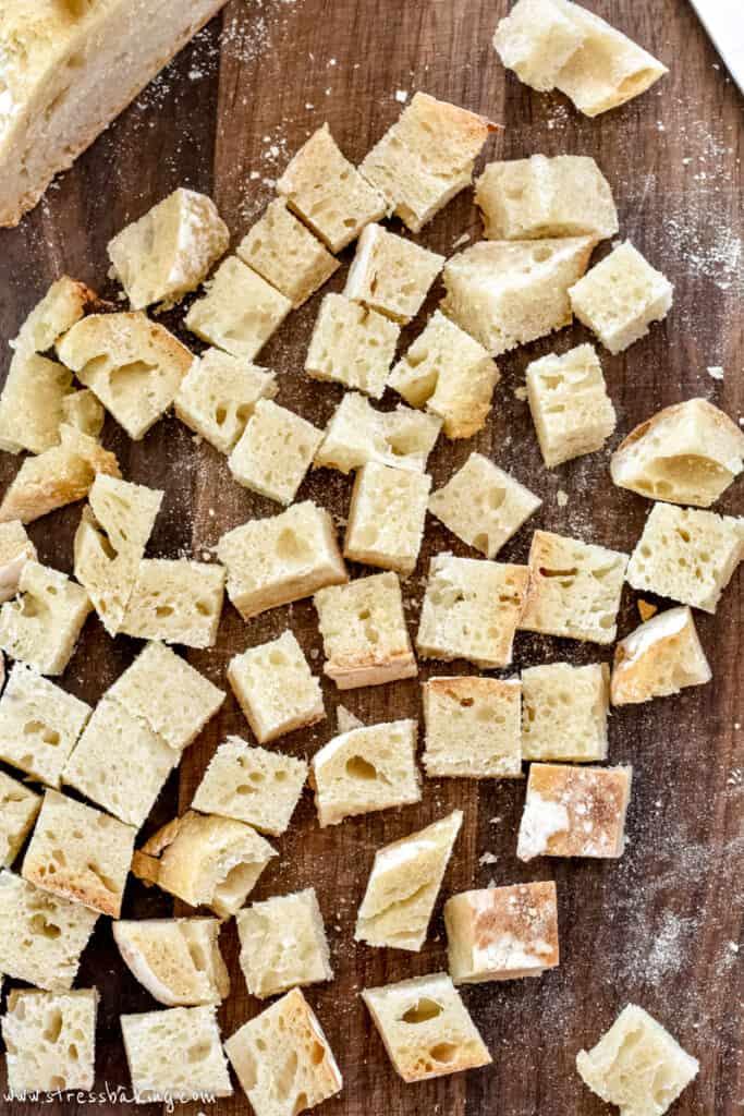 Diced sourdough bread on a cutting board